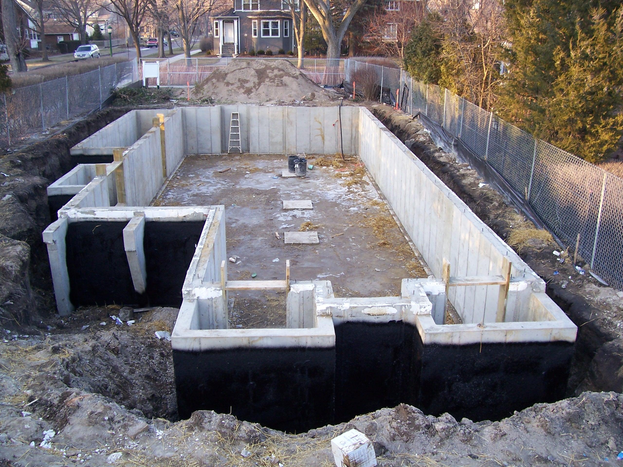 Asphalt concrete construction demolition excavation job for New home foundation